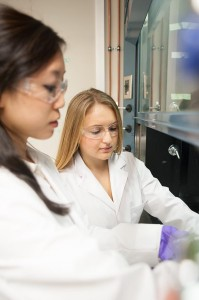 Talia Helman (right) conducts research in Assistant Professor Joe Baio's lab (photo by Mitch Lea).