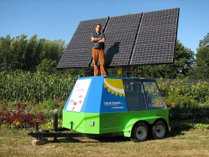 Mechanical engineering student Sam Walker and his solar trailer.