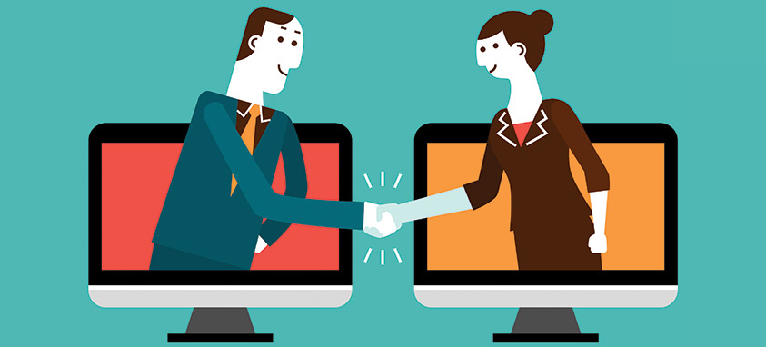 Two adults shaking hands from separate computers
