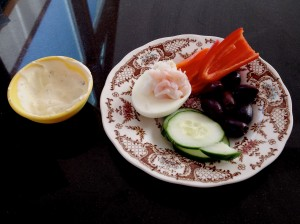 Lovely keto meal at the coast: 1/2 hard boiled egg (white only), baby shrimp in the egg, cucumber, pepper, kalamata olives and bleu cheese dip (recipe to follow).