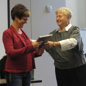 Beth Emshoff (right) presents the award to Jennifer Oppenlander (left)