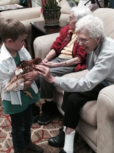 4-H youth takes a chicken to a nursing home