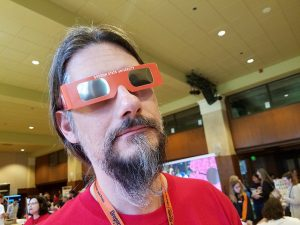 Charles Robinson sports OSU eclipse viewing glasses at the 2017 Maker Fair