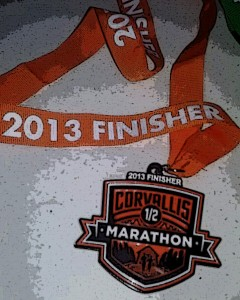 Ribbon and medal: 2013 Finisher, Corvallis Marathon.