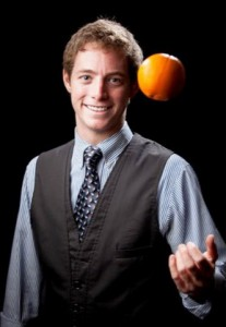 Matt tossing orange