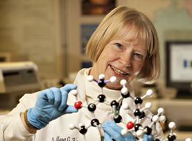 Maret Traber with molecular model.