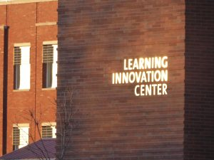Shiny Learning Innovation Center sign on brick wall of LINC building