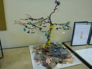 Teacher Heidi Lent and her students created a tree full of hand-sculpted invasive species to illustrate the danger of invasives.