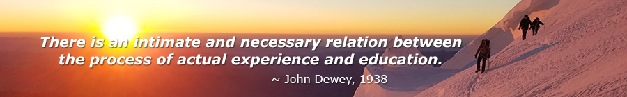 Image of mountaineers with quote by John Dewey.