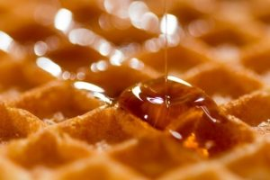 syrup poured on waffles