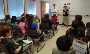 Robert Tanguay and Carrie Barton present about zebrafish research to 5th graders.