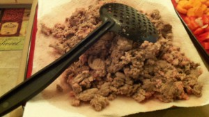 Brown until there is some pink and then remove to a paper towel covered plate to drain off the grease.