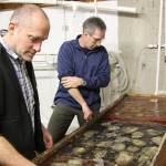 George Waldbusser and Burke Hales inspect oysters at Whiskey Creek Hatchery