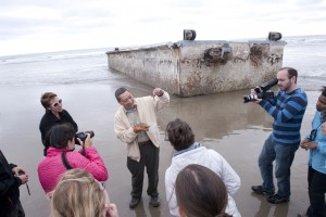 Sam Chan tells visitors to the washed-up Japanese dock about invasive species that may have hitched a ride