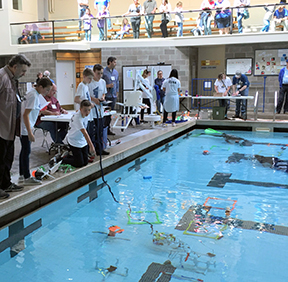 A team of students demonstrates their entry in the Oregon Regional MATE ROV competition on April 28 at the Lincoln City Community Center.