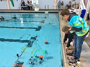 Students watch their entry's progress in the MATE ROV competition.