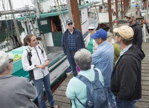 Kaety Jacobson, an Oregon Sea Grant Extension marine fisheries specialist, leads a Shop at the Dock tour in Newport.