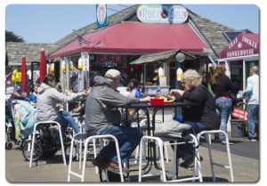 Diners enjoy lunch outside at the Port O' Call restaurant on the Oregon coast.