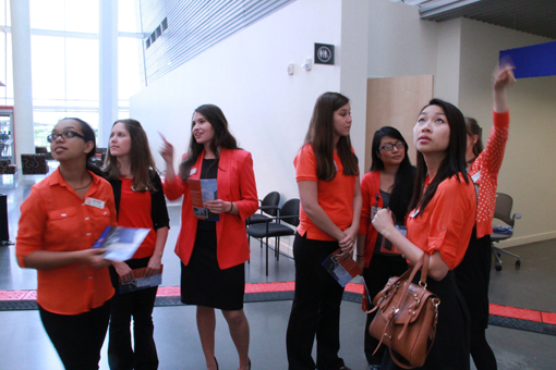 OSU/OHSU Pharmacy students admiring the lighted atrium of the CLSB.