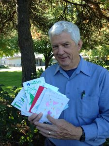MG Frank Wille displaying his array of thank you cards from students