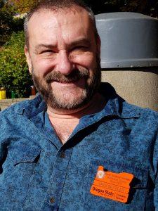 Master Gardener Greg Seagler wearing his OSU Master Gardener badge