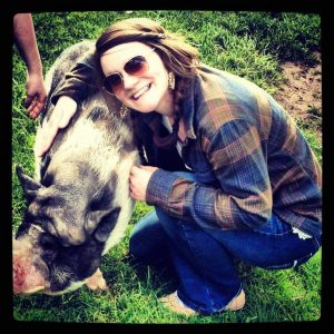 Janet Hohman smiling with a pig