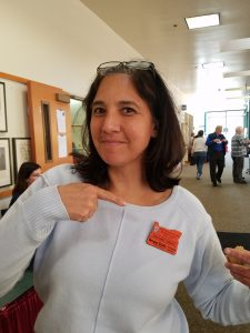 Louise Gomez-Burgess wearing her new Veteran MG badge.