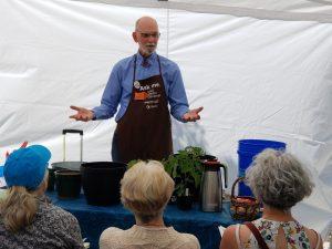Master Gardener presenting gardening talk to audience.