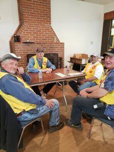 4 Master Gardener volunteers sit around table, taking a break from activities at the Spring Garden Fair.