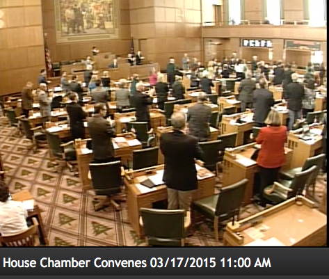 The entire chamber honors Dr. Weber's family with a prolonged standing ovation after passage of the resolution.