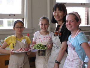 Yumiko Kishikawa with students