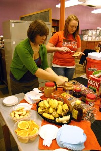 Brittinay Richmond and Jamie Nelson prepare peanut butter and jelly sandwiches