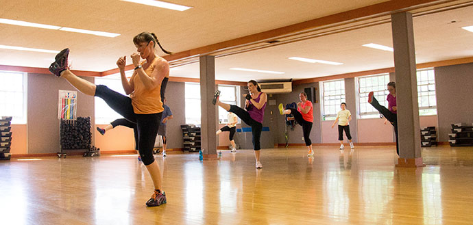 Faculty Staff Fitness Coordinator Rochelle Schwab teaches a kickboxing class.