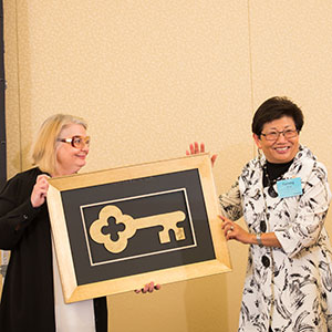 CPHHS Dean Tammy Bray (right) awards Center for Healthy Aging Research Director Carolyn Aldwin with a key to the center.