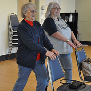 Billie Bell and daughter, Nancy Henry, stretch before starting Walk With Ease, an exercise program administered by Oregon State University's Extension Service. Photo by Kym Pokorny.