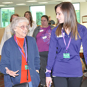 Billie Bell (left) and Sharron Palafox walk with Kelsey Evers, health educator at Salem Hospital, during a session of the Walk With Ease exercise program, which is administered by Oregon State University's Extension Service. Photo by Kym Pokorny.