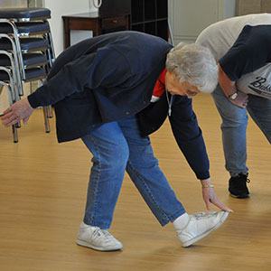 Billie Bell touches her toes in preparation for a Walk With Ease class at Salem Hospital. Photo by Kym Pokorny.