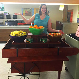 OSUDI Lisa Robinson poses with the new, upscale food cart she and Nova Elwood worked to get at Willamette High School.