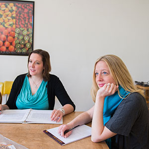 OSUDI Nova Elwood, right, and OSUDI Lisa Robinson, left, discuss nutrition consultations.