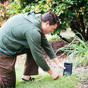 Students test out air quality monitors on campus.