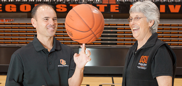 OSU Women's Basketball Head Coach and CPHHS two-time alum Scott Rueck is pictured with mentor Barb Cusimano, whom he honored at the 2019 CPHHS Hooding Ceremony.