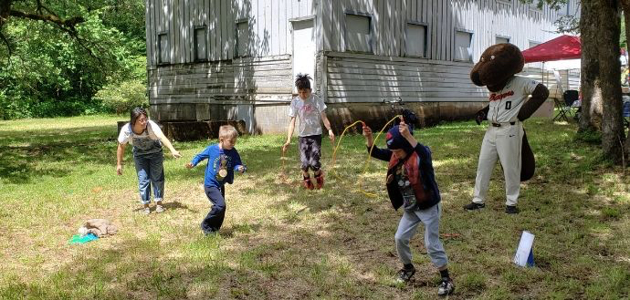 Kids participate in an obstacles course with Benny Beaver