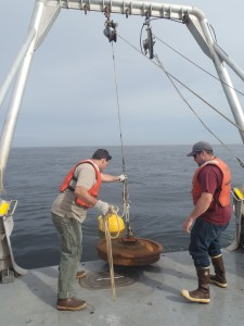 Lifting the mooring anchor off the deck to deploy the acoustic mooring at SETS