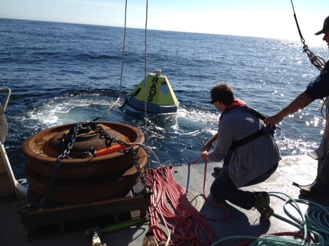 Alex Turpin helps recover the RAOS buoy after a 5 day test off the Oregon Coast.