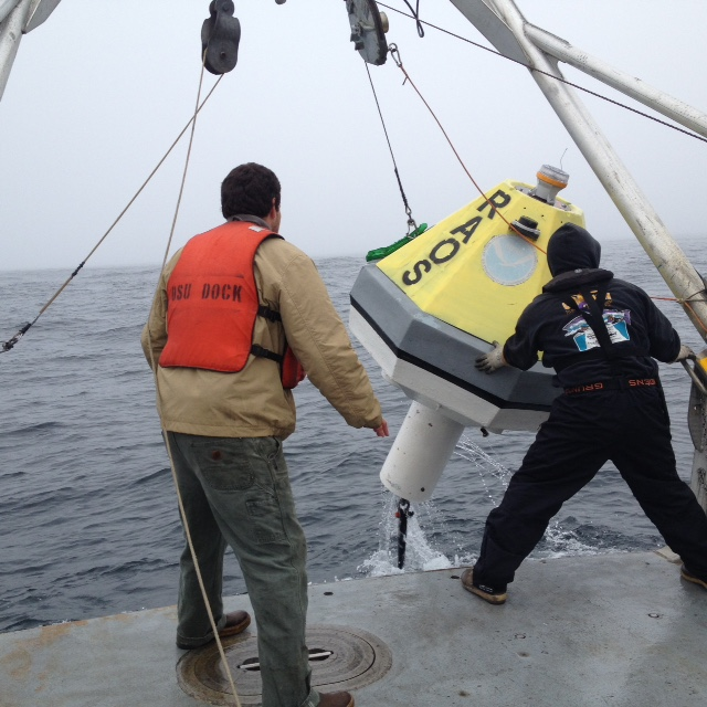 Joe Haxel stands ready to help bring in the RAOS buoy after a 5 day test off the Oregon Coast.