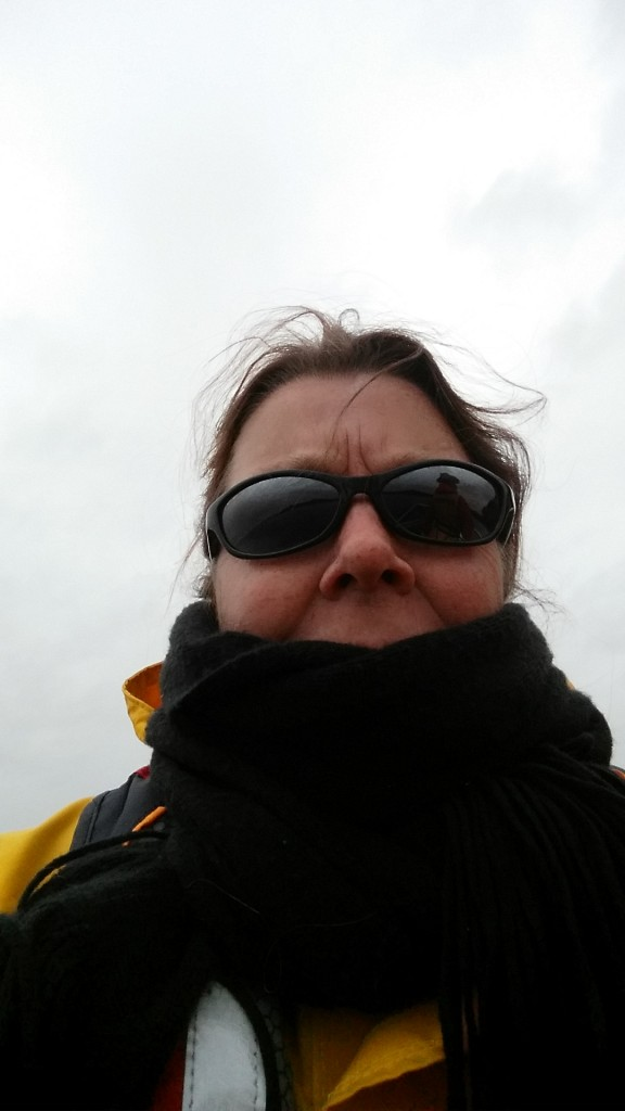 Sharon Nieukirk bundled up on the boat