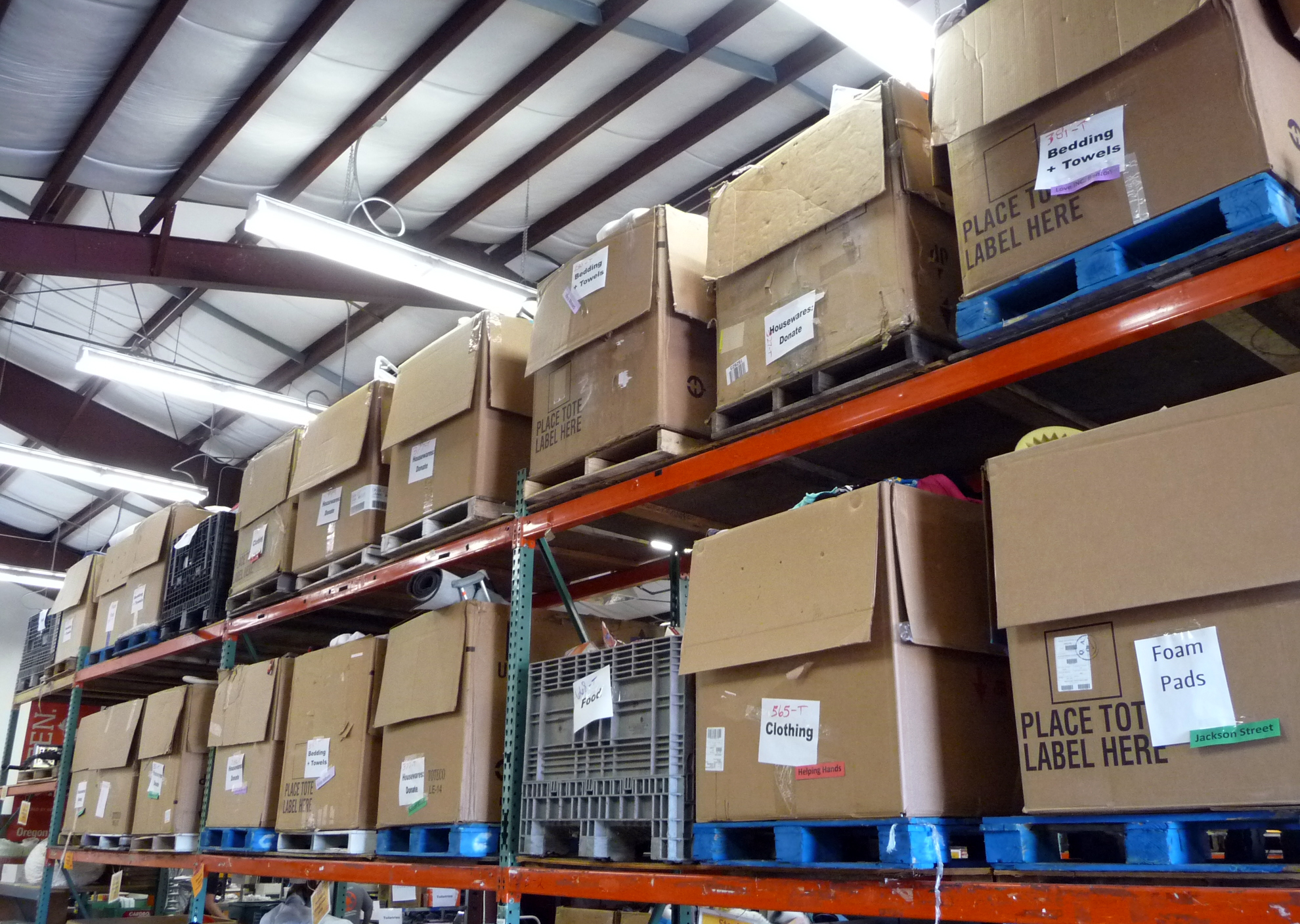 Pallet-size boxes full of donations await pick-up by non-profits.