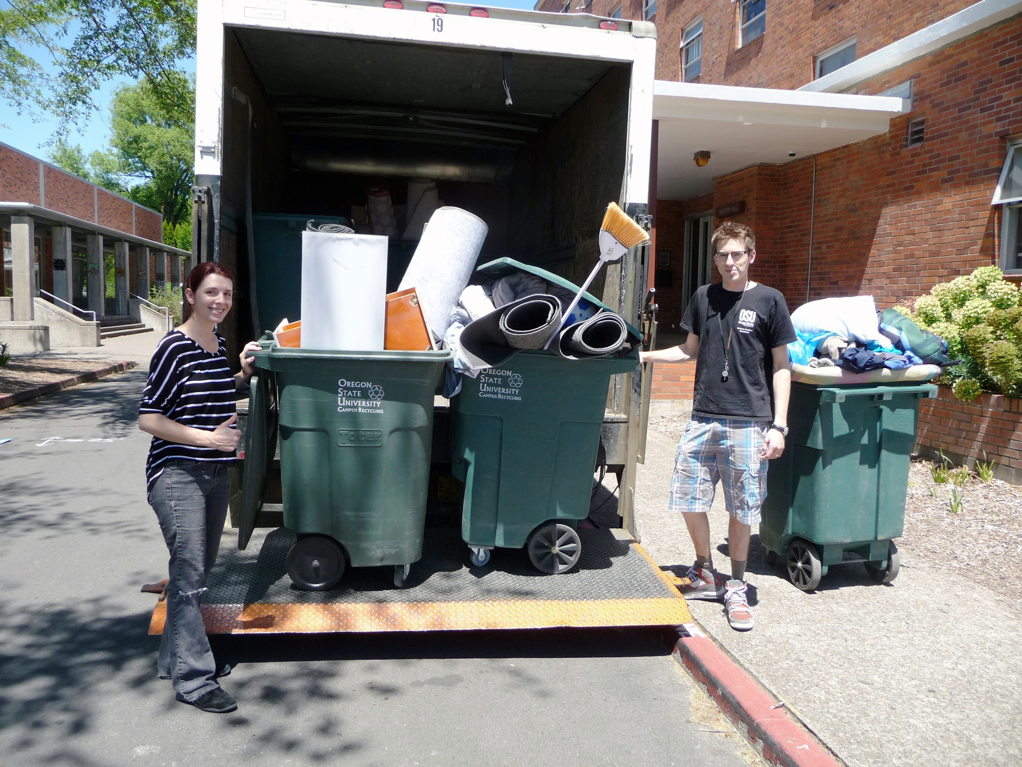 Volunteers help collect donated material during the 2016 Move-out Donation Drive.