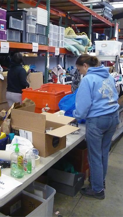 Volunteer sorting donations.
