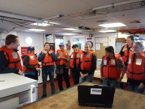 Science Party musters in the dry lab for safety debrief aboard R/V Oceanus.